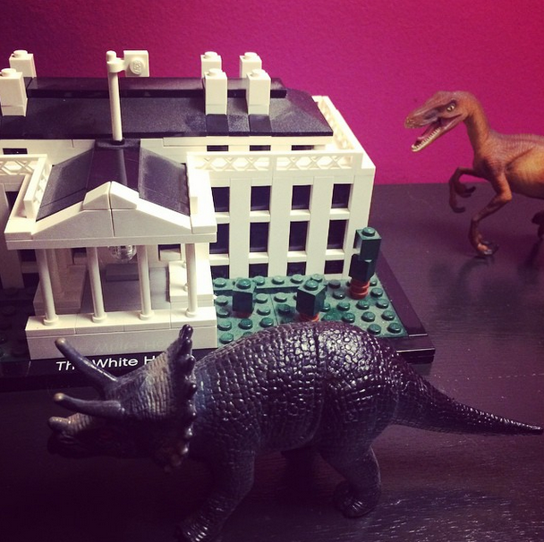 Yes, there are dinosaurs stalking the Lego White House.